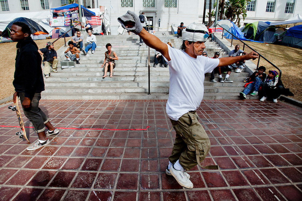 Juan Alcala dances in front of city hall during Occupy LA on Sunday, November 13, 2011 in Los Angeles, Calif. (Photo by Gabriel Romero ©2011)