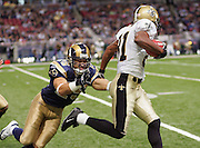ST. LOUIS - SEPTEMBER 23:  Punt and kick returner Az-Zahir Hakim #81 of the New Orleans Saints dodges a tackle by Mike Furrey #25 of the St. Louis Rams on a kick return at the Edward Jones Dome on September 23, 2005 in St. Louis, Missouri. The Rams defeated the Saints 28-17. ©Paul Anthony Spinelli *** Local Caption *** Az-Zahir Hakim;Mike Furrey