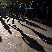 NYTRUN - NOV. 6, 2016 - NEW YORK - Young runners warm up on East Drive ahead of the NYRR Youth Invitational near East 86th Street in Central Park in Manhattan on Sunday morning. NYTCREDIT:  Karsten Moran for The New York Times