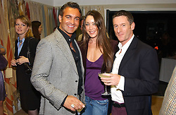 Left to right, MARTYN LAWRENCE-BULLARD, TAMARA MELLON and PETER DUNHAM at a party hosted by Kathryn Ireland held at her showroom at 65-69 Lots Road, London on 27th September 2005.<br /><br />NON EXCLUSIVE - WORLD RIGHTS