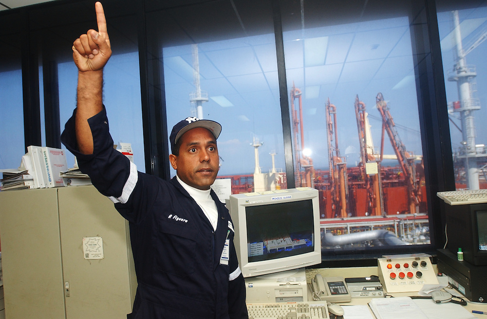Inside the control center of an offshore crude oil loading platform at the Jose complex.