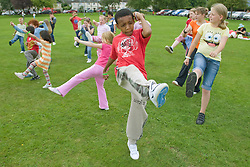 Group of children taking part in a Superhero workout at a Parklife summer activities event