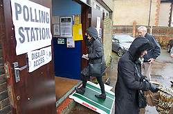 ©Licensed to London News Pictures 12/12/2019. <br /> Bromley ,UK. People battle against the wet weather to vote in the UK General Election at St Augustine scout hall, Bromley, South East London.          Photo credit: Grant Falvey/LNP