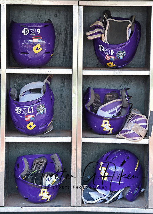 A general view of the LSU Tigers batting helmets, prior to game one of the College World Series Championship Series against the Florida Gators at TD Ameritrade Park in Omaha, Nebraska.