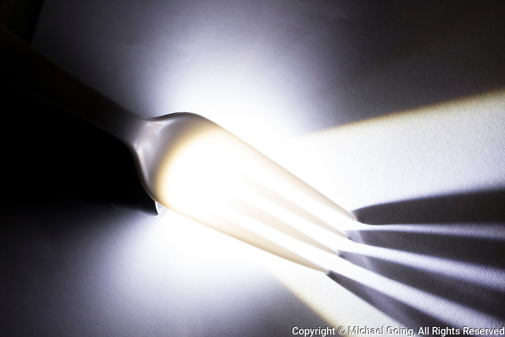 Light streaks on glowing plastic fork