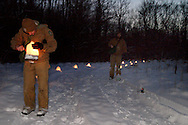 Wes Matthews of Sugarcreek (left) and Jorge Sanchez of Centerville help light the candles before the Holiday stroll and luminaria walk from Forest Field Park, through the meadows of Bill Yeck Park to the historic Smith home, part of the Centerville-Washington Township Park District, Friday, December 17, 2010.