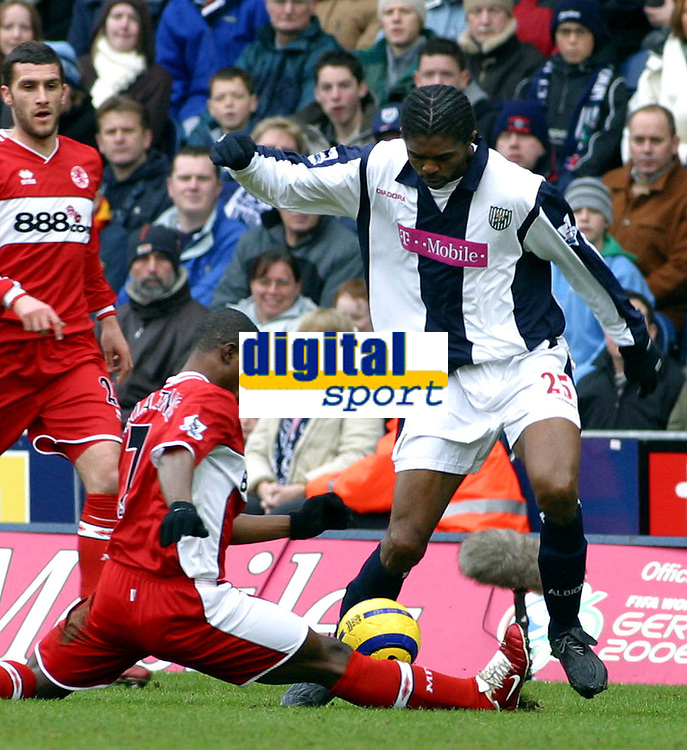 Photo: Dave Linney.<br />West Bromwich Albion v Middlesbrough. The Barclays Premiership. 26/02/2006West Brom's .Kanu(R) escapes a late tackle by George Boateng