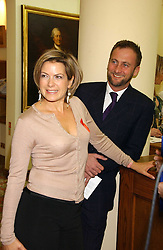 TV presenter PENNY SMITH and boyfriend VINCE LEIGH at the Lighthouse Gala Auction in aid of the Terrence Higgins Trust held at Christie's, St.James's, London on 15th March 2006.<br />