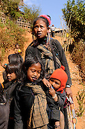 Myanmar/Burma.  Eng family. Eng hilltribe  lives in the villages of the eastern part of Myanmar. They are animists and are famous for black tunics and metal armlets and blackening their teeth with betel nut and black dye.