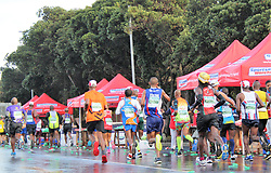 Runners take part in the Old Mutual Two Oceans Ultra Marathon in Cape Town. The ultra is 56km.