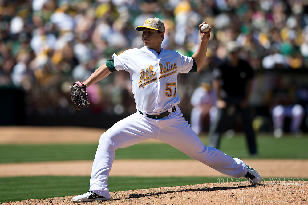 OAKLAND, CA - MAY 26:  Tommy Milone #57 of the Oakland Athletics pitches against the Detroit Tigers during the sixth inning at O.co Coliseum on May 26, 2014 in Oakland, California. The Oakland Athletics defeated the Detroit Tigers 10-0.  (Photo by Jason O. Watson/Getty Images) *** Local Caption *** Tommy Milone