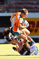 Deon Carstens tackles Johan Goosen during the DHL Pre-Season Series match between The Stormers and the Cheetahs held at Newlands Rugby Stadium in Newlands, Cape Town on the 4th February 2012.Photo by Ron Gaunt/SPORTZPICS