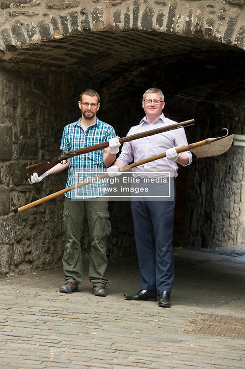 Pictured: Curator Nico Tyack (holding musket) and Museum Assistant David Mclay (holding a halberd)<br /> <br /> The latest Museum of Edinburgh exhibition documents the history of Edinburgh's Town Guard, which brought law and order to the city in the 18th century. Curator Nico Tyack and Museum Assistant David Mclay examined muskets, halberds and drums before the exhibition was opened to the public<br /> <br /> Ger Harley | EEm 15 June 2017