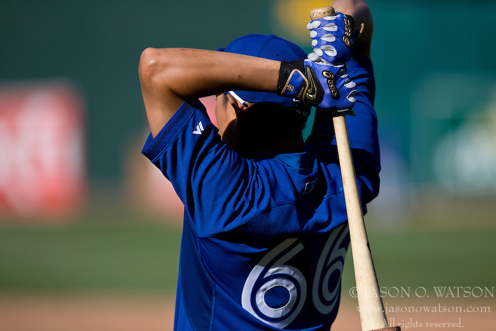 OAKLAND, CA - JULY 05:  Munenori Kawasaki #66 of the Toronto Blue Jays holds a bat during batting practice before the game against the Oakland Athletics at O.co Coliseum on July 5, 2014 in Oakland, California. The Oakland Athletics defeated the Toronto Blue Jays 5-1.  (Photo by Jason O. Watson/Getty Images) *** Local Caption *** Munenori Kawasaki