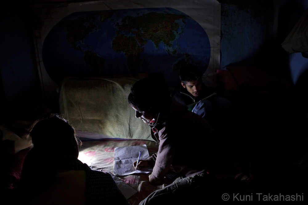 (Jan 7, 2012 - Kathmandu, Nepal).Children study under a flash light during power outage in Kathmandu, Nepal, on Jan 7, 2012. For the last several years, nearly 800,000 people of the capital city faced up to 16 hours of blackouts every day, mainly caused by political instability. Nepal is said to be second only to Brazil in terms of water resources but the government has been incapable of harnessing hydropower..(Photo by Kuni Takahashi)