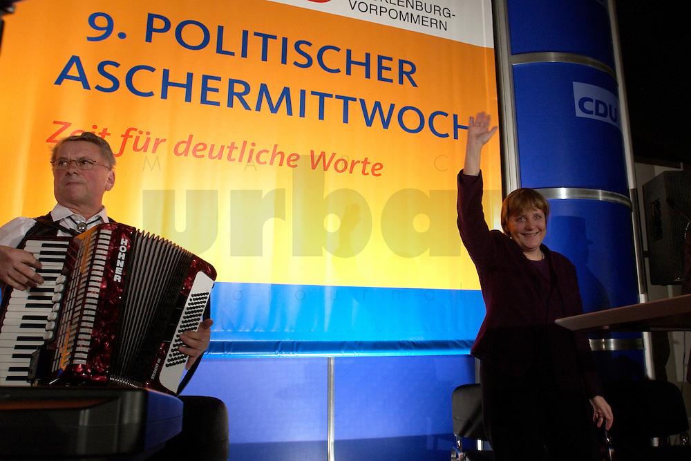 25 FEB 2004, DEMMIN/GERMANY:<br /> Angela Merkel, CDU Bundesvorsitzende, nach ihrer Rede, Politischer Aschermittwoch der CDU Mecklenburg-Vorpommern, Tennis- und Squash Center Demmin<br /> IMAGE: 20040225-02-046