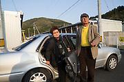 Sadako Tomura, a passanger of Shinji Aoyama, a retired man who drives a car for the Japan Car Sharing Association in Ishinomaki, Japan.