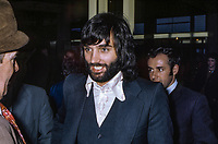 George Best, N Ireland and Manchester United footballer. Circumstances in whcih picture was taken are unknown. Looks like he is arriving or departing an airport, probably Belfast International. 19710510001, Linenhall,  233/71.<br />