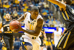 Nov 13, 2015; Morgantown, WV, USA; West Virginia Mountaineers guard Teyvon Myers drives to the basket during the first half against the Northern Kentucky Norse at WVU Coliseum. Mandatory Credit: Ben Queen-USA TODAY Sports