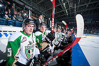 KELOWNA, CANADA - DECEMBER 6: Sean Montgomery #25 and Darcy Zaharichuk #27 of Prince Albert Raiders sit on the bench at the start of the game against the Kelowna Rocketson December 6, 2014 at Prospera Place in Kelowna, British Columbia, Canada.  (Photo by Marissa Baecker/Shoot the Breeze)  *** Local Caption *** Sean Montgomery; Darcy Zaharichuk;