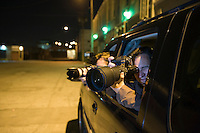 Paparazzi photographer in car
