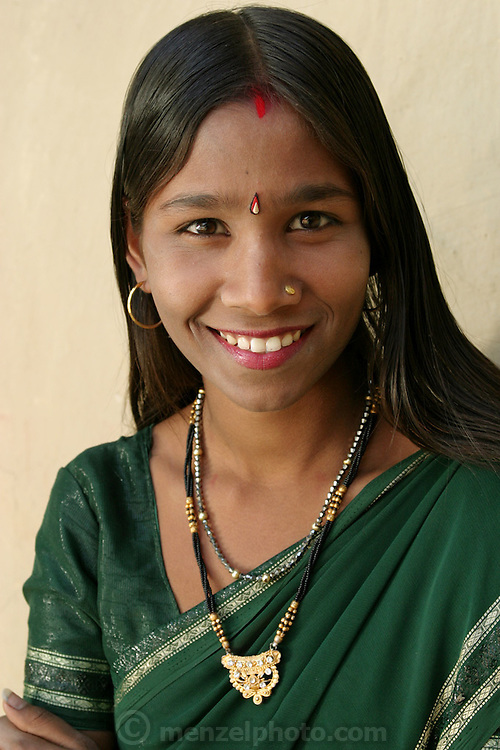 IND.MWdrv04.366.x..Bachau and Mishri Yadav's oldest child, daughter Nishadevi, 19, called Guddi, is betrothed by family arrangement to a boy living in a village 30 km from her home village of Ahraura Village, Uttar Pradesh, India. Revisit with the family, 2004. The Yadavs were India's participants in Material World: A Global Family Portrait, 1994 (pages: 64-65), for which they took all of their possessions out of their house for a family-and-possessions-portrait. Child, Children, Marriage..