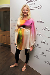 JODIE KIDD at a pool party to celebrate the UK launch of the Omega Ladymatic Collection held at the Haymarket Hotel, Haymarket, London on 16th June 2011.