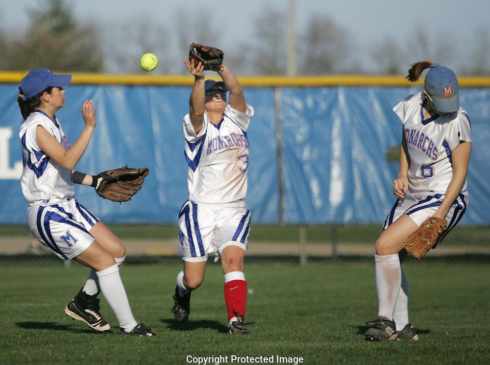 An Olentangy pop fly goes off of Marysville center fielder Darik Parker's (3) glove as left fielder Kadie Sepeda (34) and short stop Heather Halola (6) converge Friday April 17, 2009 at Marysville.(Jodi Miller/ThisWeek)
