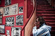 Man passing through mural