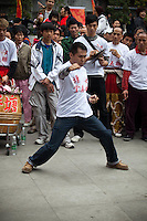 Martial arts demonstration just before a lion dance at a temple festival in old Liwan district of Guangzhou.