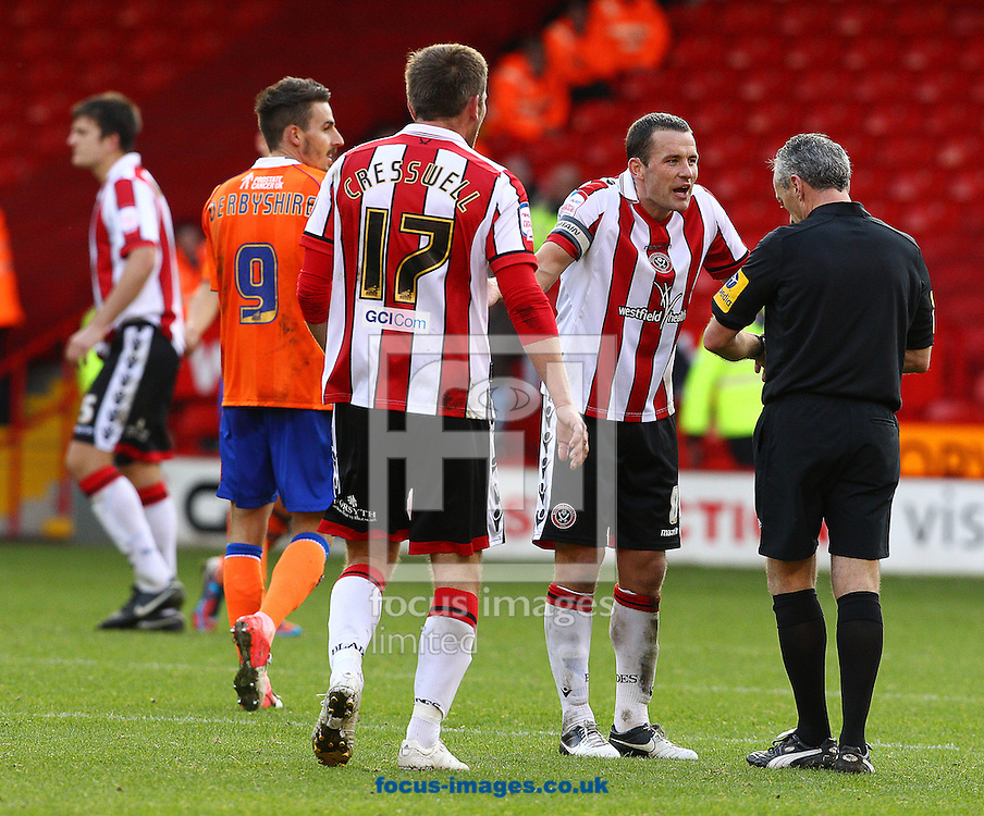 Picture by Paul Terry/Focus Images Ltd +44 7545 642257.13/10/2012.Michael Doyle ( 2nd R) of Sheffield Utd complains to the Referee about the time added on after the npower League 1 match at Bramall Lane, Sheffield.