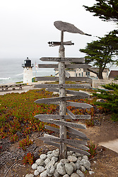 Sign pointing directions to cities across the globe, Point Montara Light Station, Montara, California, United States of America