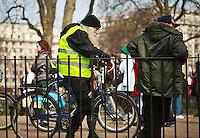 Men listen at Speaker's Corner in Hyde Park, London, England.