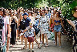 © Licensed to London News Pictures. 01/07/2018. London, UK. People queue for Hampstead Heath Mixed Bathing Pond in north London on Sunday, July 1, 2018 as heatwave has reached 31C and is set to continue into the next week and the unusually high temperatures look set to remain until the week after next. Photo credit: Tolga Akmen/LNP