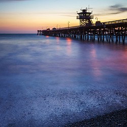 California San Clemente pier at sunset picture. San Clemente is a popular coastal city in Orange County California in the United States of America. Copyright ⓒ 2017 Paul Velgos with all rights reserved.
