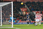 Header from Leeds United defender Luke Ayling (2)  brings a save from Stoke City goalkeeper Jack Butland (1)  during the EFL Sky Bet Championship match between Stoke City and Leeds United at the Bet365 Stadium, Stoke-on-Trent, England on 19 January 2019.