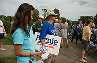 The crowd gathered on the back lawn of the Wolfeboro Inn awaiting the arrival of Democratic Presidential candidate Bernie Sanders to arrive on Monday evening.   (Karen Bobotas/for the Laconia Daily Sun)