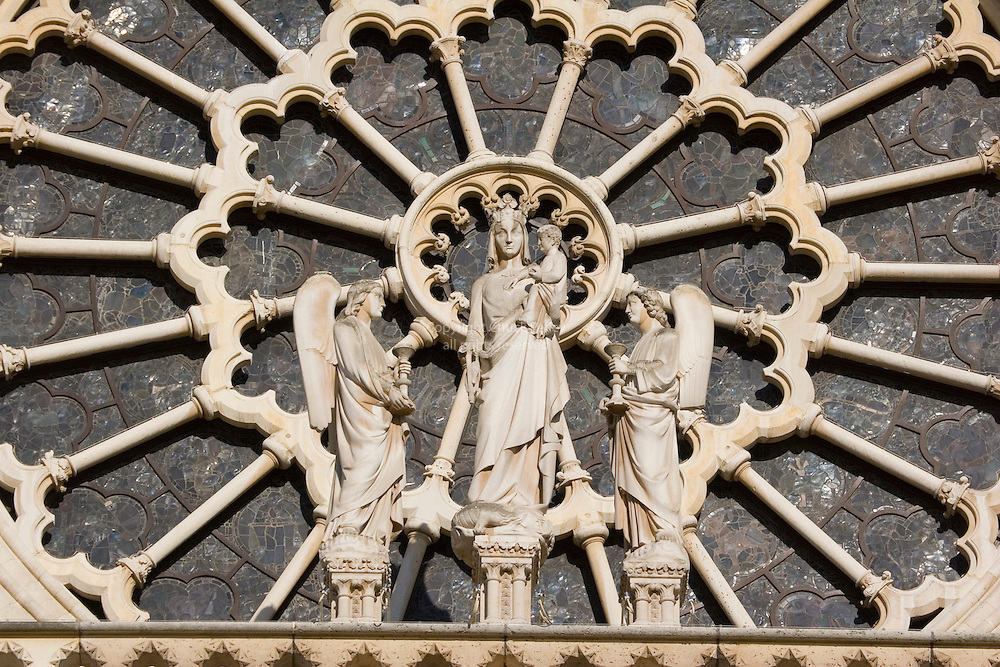 Statuary and carvings in window of Notre Dame Cathedral, Paris France<br />