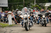 Brenda Ganong leads the way for riders participating in the 13th annual Brenda's Ride with Friends departing from Faro Italian Grille on Saturday morning.  Proceeds from the ride to benefit LRGHealthcare Oncology Department.  (Karen Bobotas/for the Laconia Daily Sun)