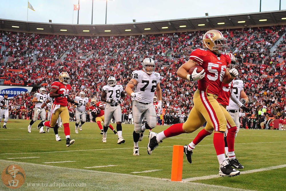August 22, 2009; San Francisco, CA, USA; San Francisco 49ers linebacker Scott McKillop (56) carries the ball during the fourth quarter against the Oakland Raiders at Candlestick Park. The 49ers defeated the Raiders 21-20. Mandatory Credit: Kyle Terada-Terada Photo