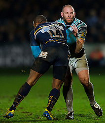 Leicester Hooker (#2) Rob Hawkins is tackled by Worcester Winger (#14) Josh Drauniniu during the second half of the match - Photo mandatory by-line: Rogan Thomson/JMP - Tel: Mobile: 07966 386802 04/01/2012 - SPORT - RUGBY - Sixways - Worcester. Worcester Warriors v Leicester Tigers - Aviva Premiership.