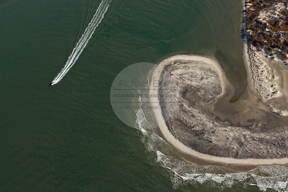 Aerial view of a boat passing Bird Key at Stono Inlet in Folly Beach, SC.