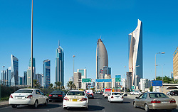 Skyline of downtown Kuwait City and traffic on highway in Kuwait, Middle East