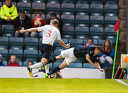 Falkirk's Stephen Kingsley pushes over Dundee's Nicolas Riley.<br /> Dundee 1 v 1 Falkirk, Scottish Championship game at Dundee's home ground Dens Park.<br /> &copy;Michael Schofield.