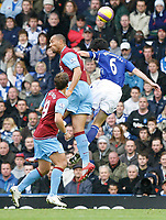 Photo: Steve Bond/Sportsbeat Images.<br /> Birmingham City v Aston Villa. The FA Barclays Premiership. 11/11/2007. John Carew (C) and Liam Ridgewell (R) contest a cross. Stiliyan Petrov (L) looks on