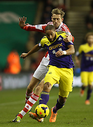 Stoke's Peter Crouch battles with Swansea's Ashley Williams - Photo mandatory by-line: Matt Bunn/JMP - Tel: Mobile: 07966 386802 10/02/2014 - SPORT - FOOTBALL - Stoke - Britannia Stadium - Stoke City  v Swansea City - Barclays Premiership