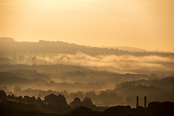 © Licensed to London News Pictures. 13/09/2016. Shipley UK. Picture shows low lying fog at sunrise this morning over the town of Shipley on what is predicted to be the hottest day in September. Photo credit: Andrew McCaren/LNP