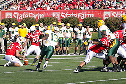 16 October 2010:  Freddie Banks rushes a place kick by Steven Fetzer being held by Matt Lancaster during a game where the North Dakota State Bison lost to the Illinois State Redbirds 34-24, meeting at Hancock Stadium on the campus of Illinois State University in Normal Illinois.
