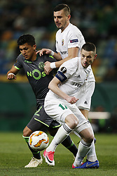December 13, 2018 - Lisbon, Portugal - Fredy Montero of Sporting (L) vies for the ball with Volodymry Chesnakov of Vorskla  (R) and Olexandr Chyzhov of Vorskla (C)  during UEFA Europa League football match between Sporting CP vs Vorskla, in Lisbon, on December 13, 2018. (Credit Image: © Carlos Palma/NurPhoto via ZUMA Press)