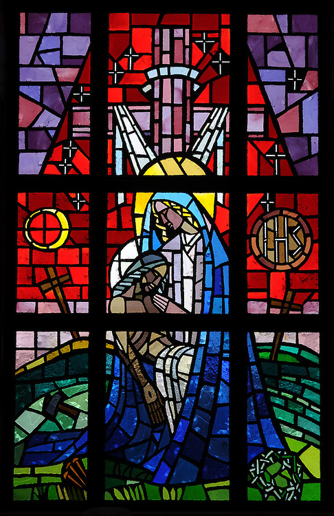 Stained glass image of Mary holding her crucified son Jesus from Allouez Cemetery in Green Bay. (Photo by Sam Lucero)